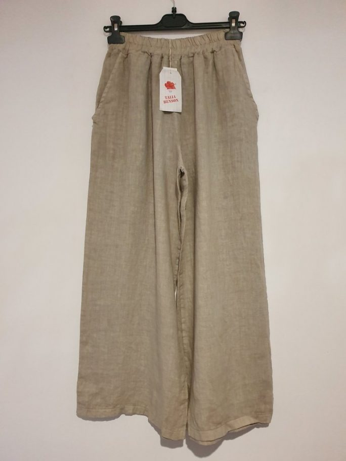 The classic Italian linen palazzo pant with an elastic waist falling to wider longer legs - suit everyone from the short body shape to the tall. pants-104-olivia-03-natural