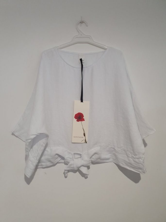 This stylish Italian linen boxy top features three-quarter sleeves with a front tie at the waist. top-104-adeline-01-white