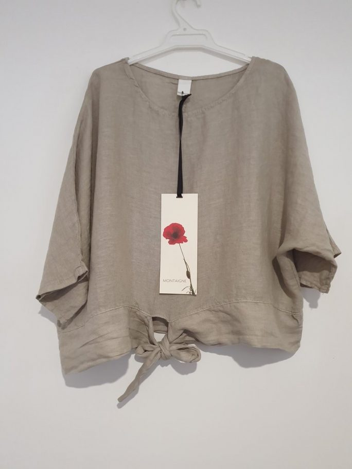 This stylish Italian linen boxy top features three-quarter sleeves with a front tie at the waist. top-104-adeline-02-taupe