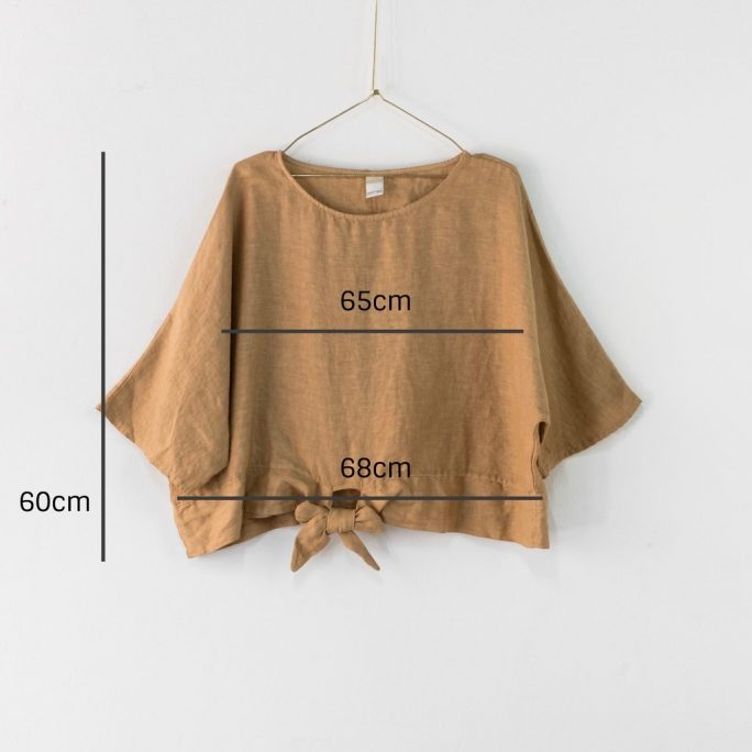 This stylish Italian linen boxy top features three-quarter sleeves with a front tie at the waist. top-104-adeline-05-ochre