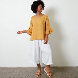 Our elegant Portia top in Italian linen fits most and takes you anywhere from lunch to a big birthday, from drinks to dinner and looks fantastic with jeans or shorts. top-110-portia-03-mustard